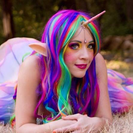The artist cosplaying as a rainicorn.